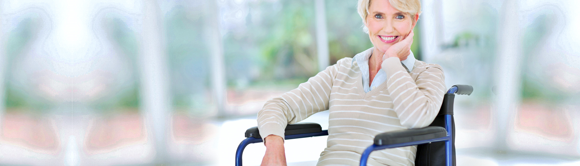 elderly woman in a wheelchair smiling