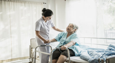 Young nurse take care of senior patient In Hospital Room