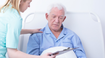 caregiver and elderly man talking